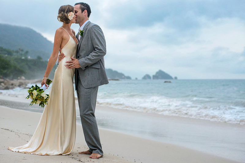 Married Couple Kissing on the Beach